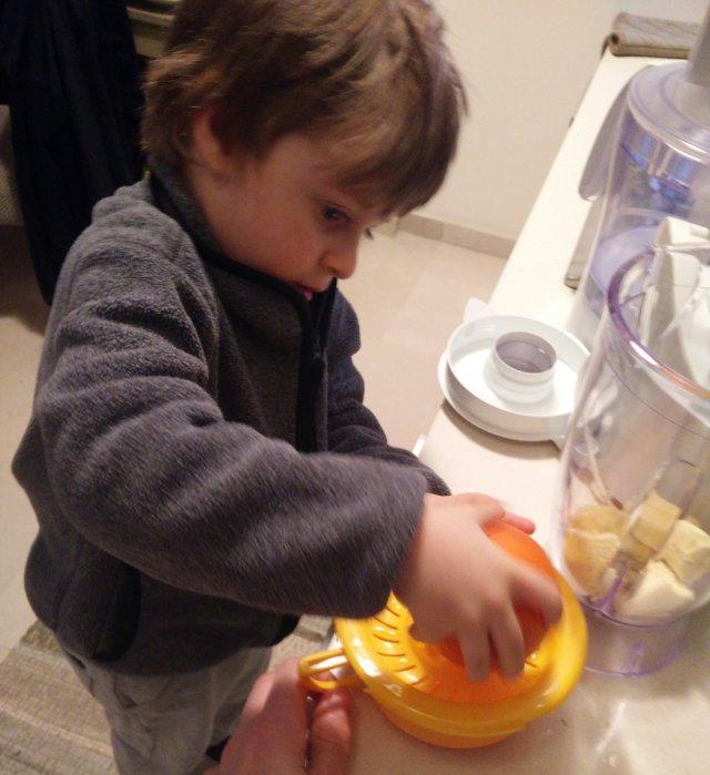 child making orange juice