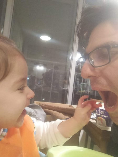child feeding dad